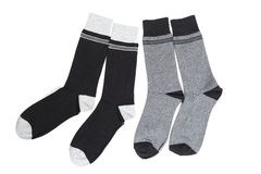 socks-two-pairs-dark-coloured-laid-over-white-background-35449006.jpg