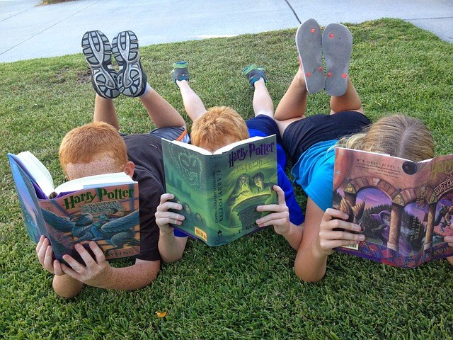 Kids on grass reading.jpg